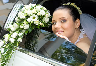 Bride sits in limousine